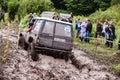 Toyota LandCruiser Prado 70 driving through deep mud. Royalty Free Stock Photo