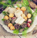 Toys for the Christmas   tree and pine cones in a metal bowl, on old wooden background  new Year Royalty Free Stock Photo