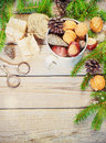 Toys for the Christmas   tree and pine cones on old wooden background  new Year Royalty Free Stock Photo