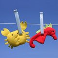 Toys hanging on clothesline two funny sea creature Royalty Free Stock Image