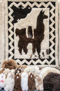 Toys and llama rug rugs on the market in otavalo ecuador Stock Photo