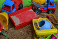 Toys in the sandbox dirty color plastic Stock Photo