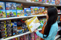 Toys young woman choosing in a supermarket to purchase image taken on the th of december in intermarche supermarket in the algarve Royalty Free Stock Images