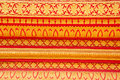Tracery on wall temple thai art and red gold paint in thailand Royalty Free Stock Image