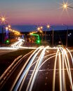 Traces of headlights from cars moving at night on the bridge, illuminated by lanterns. Abstract city landscape with highway Royalty Free Stock Photo
