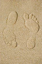 Traces on sand of barefooted foots Stock Images