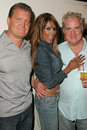 Traci bingham clement von franckenstein tracy bingham john clements and her fiance with at champagne and bikinis hosted by geoff Royalty Free Stock Photo