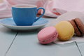 Tracing paper cornet with macarons and blue espresso cup close up Royalty Free Stock Photos