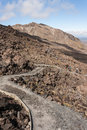 Track across volcanic terrain in tongariro national park in new zealand Stock Image