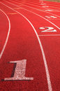 Track Field rounding first curve lane numbers Royalty Free Stock Photo