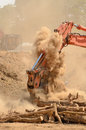 Track hoe excavator working on a top soil pile for later use on a new commercial construction development project Royalty Free Stock Photos