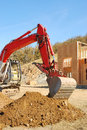 Track hoe large exchavator working a dirt pile at a new commercial construction site in roseburg oregon Stock Images