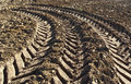 Track of a tractor on plowed field Royalty Free Stock Images