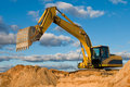 Track-type loader excavator at sand Royalty Free Stock Photo