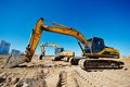 Track type loader excavators at work two excavator machine earthmoving in sand quarry Royalty Free Stock Photos