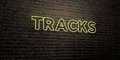 TRACKS -Realistic Neon Sign on Brick Wall background - 3D rendered royalty free stock image