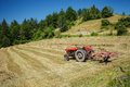 Tracktor on a field old the with dry hay serbia Stock Photography