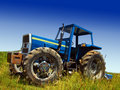 Blue tractor in field Royalty Free Stock Photo