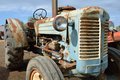 Tractor an abandoned rusty vintage in countryside Royalty Free Stock Photography