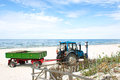 Tractor on the beach. Royalty Free Stock Photo