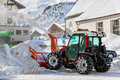Tractor blower cleaning snow in street obergurgl austria Royalty Free Stock Image