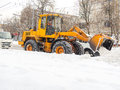 Tractor clears snow in the winter Royalty Free Stock Photo