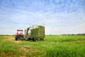 Tractor combine grass cutting. Royalty Free Stock Photo