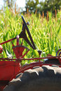 Tractor and corn old in front of a field of sweet at a truck farm in roseburg oregon Royalty Free Stock Images