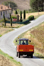 Tractor on country road modern with carriage moving Stock Photos