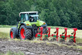 Tractor cultivating Stock Image