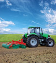 Tractor cultivating in the field Stock Images