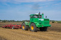 Tractor cultivating in the field lithuania country Royalty Free Stock Image