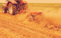 Tractor cultivating wheat stubble field Royalty Free Stock Photo