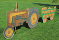 Tractor cutout display a plywood of a pulling a cart full of pumpkins Stock Image