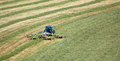 Tractor Cutting Grass Field with Hay Bob Royalty Free Stock Photo