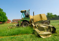 Tractor cutting grass meadow Royalty Free Stock Photo