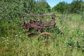 A tractor drawn plow an antique furrow pulled by in pioneer days Stock Images