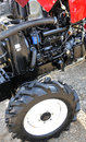 Tractor engine open with wheel Royalty Free Stock Photos