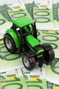 Tractor on euro banknotes Royalty Free Stock Photography