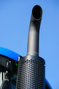 Tractor exhaust pipe. blue sky background