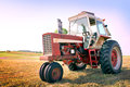 Tractor a farm in a freshly mowed field Royalty Free Stock Image