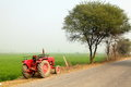 Tractor farm land a is on countryside landscape Royalty Free Stock Image