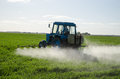 Tractor fertilize field pesticide and insecticide Royalty Free Stock Photo