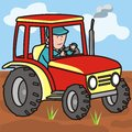 Tractor on the field driver of goes through Royalty Free Stock Photo