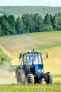 Tractor in a field in early summer Royalty Free Stock Photo