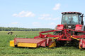 Tractor on the field, surrounded by storks Royalty Free Stock Photo
