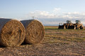 Tractor in a fresh cut hay field Royalty Free Stock Photo