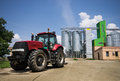 Tractor in front of silos parked grain Royalty Free Stock Photo