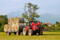 Tractor with hay bales barrow Royalty Free Stock Photo