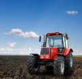 Tractor modern farm equipment field Stock Photos